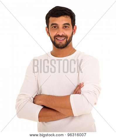 handsome young indian man with arms folded