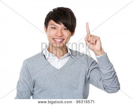 Young businessman with finger point up