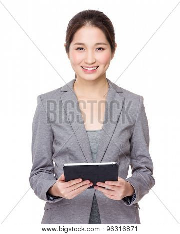 Asian young Businesswoman use of tablet pc