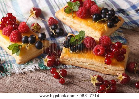 Small Berry Pies With Honey And Mint Close-up. Horizontal