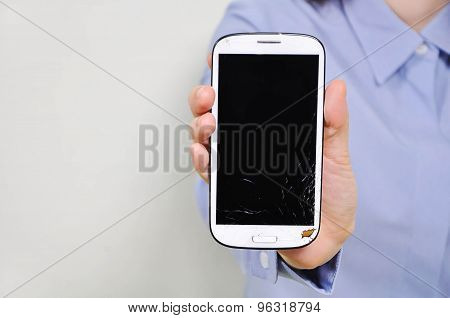 Hand Showing Cell Phone.