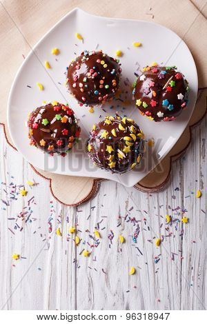 Chocolate Apples With Sprinkles Candy. Vertical Top View