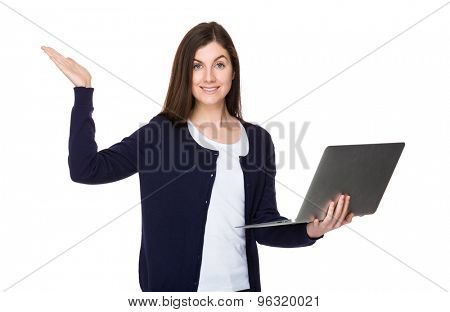 Caucasian woman use of notebook computer and open hand palm