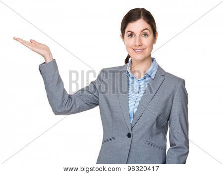 Brunette businesswoman with open hand palm