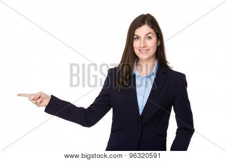 Caucasian businesswoman with finger point aside