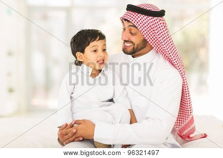 lovely Arabic man talking to his son