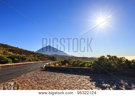 Sun With Sunlight Over Mountains On Blue Sky With Fog And Teide Volcano, Tenerife, Canary Islands, S