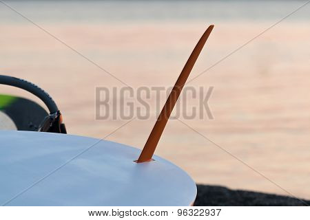 Surfboard fin against the ocean.