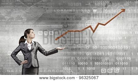 Businesswoman carrying big increasing graph. Growth concept