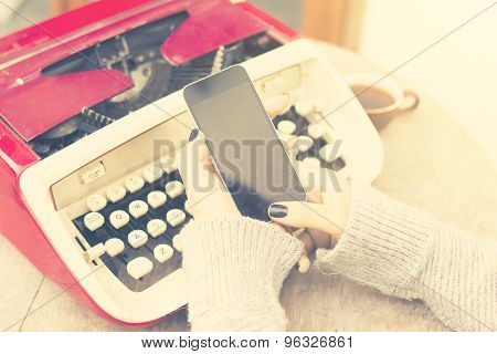 Girl With Blank Cell Phone And Typewriter, Vintage Photo Effect