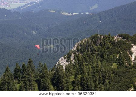 Paraglider Flying Over Bavarian Mountains