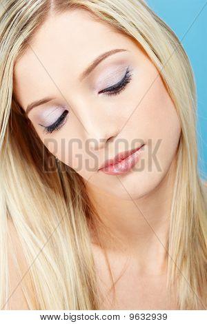Blonde Girl Making Up