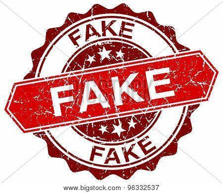 Fake Red Round Grunge Stamp On White