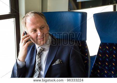Businessman Calling From A Train