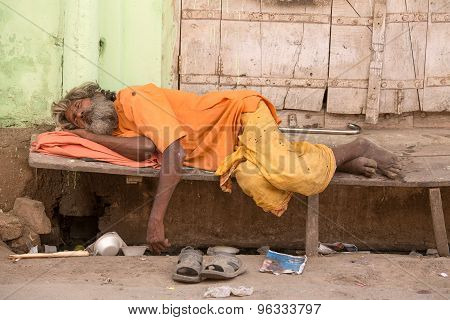 Indian Homeless Man Sleeps On The Street. Pushkar, India