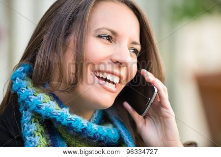 Beautiful woman talking on cell phone