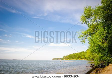 Deserted Beach On The Sea In Summer Sunny Day