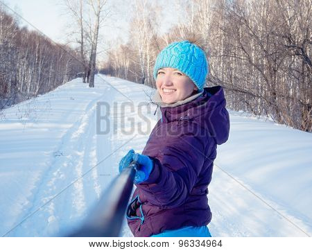 The Girl On The Background Of A Winter Forest Makes The Photo Self