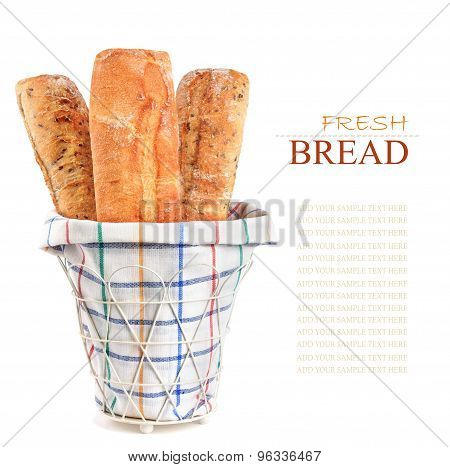 Three Fresh Loaf In Basket Isolated On Background