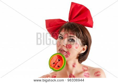 beautiful girl with lollipop in mouth in lipstick kisses