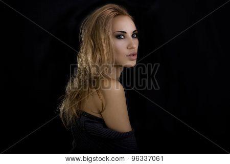 Beautiful Sexy Blond Woman. Dark Background. Smokey Eyes Makeup And Naturally Styled Hair.
