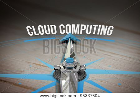 The word cloud computing and compass against brown wooden background
