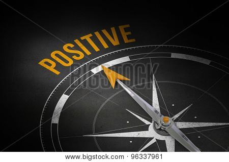 The word positive and compass against black wall