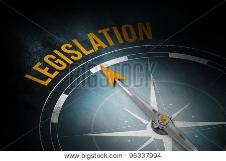 The word leglislation and compass against dark background