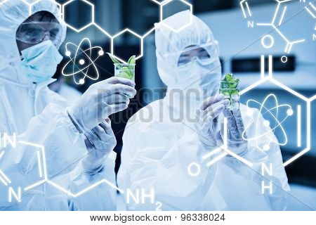 Science graphic against students in protective suits looking at plants in beakers