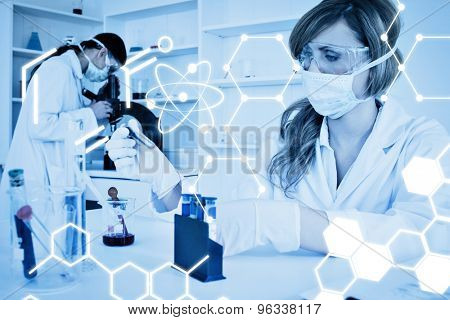 Science graphic against two female scientists conducting an experiment