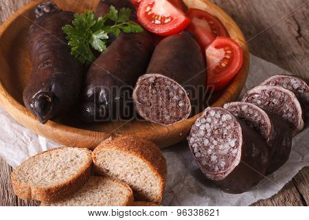 Fresh Blood Sausages And Vegetables Close-up. Horizontal