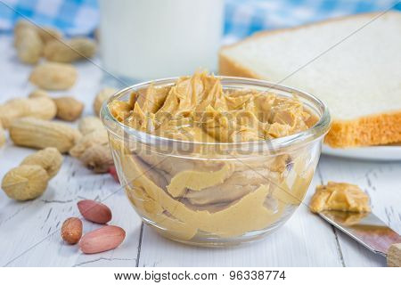 Creamy Peanut Butter With Nuts And Glass Of Milk