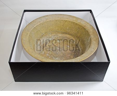 Old vintage cooper round pan isolated in black box