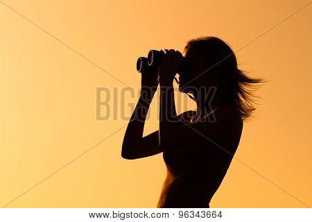 Enjoying in sunset with binoculars