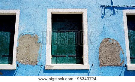 Three Windows In Burano On Decay Blue Wall