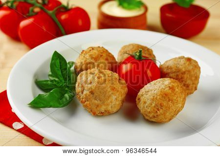 Meat balls on plate, on wooden table background