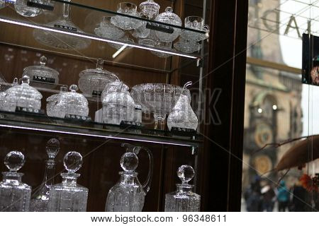 PRAGUE, CZECH REPUBLIC - NOVEMBER 9, 2014: Bohemian glass offered by the souvenir shop Erpet Bohemia Crystal at Old Town Square in Prague, Czech Republic.