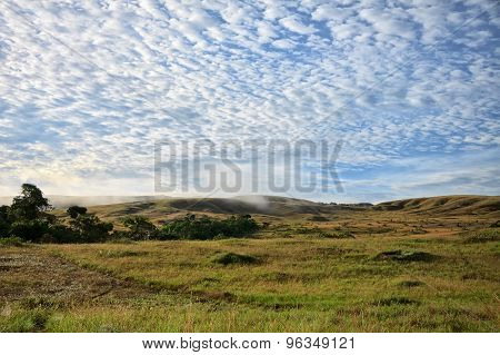 View To Hills Of Savanna Under Stunning Sunny Cloudy Sky
