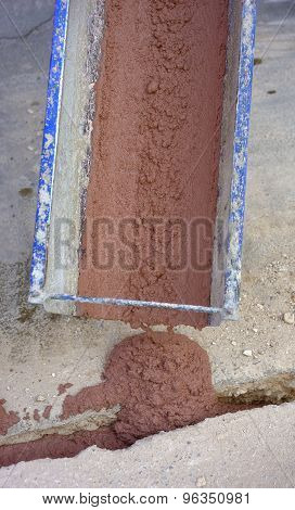 Pouring concrete colored red