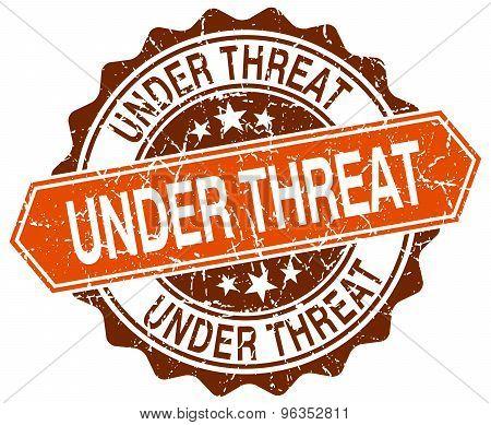 Under Threat Orange Round Grunge Stamp On White