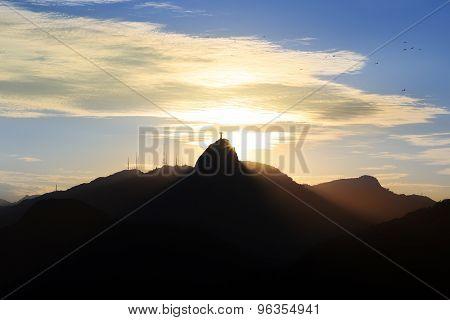 RIO DE JANEIRO- April 18: Sunset behind Mountain Corcovado on April 18, 2015 in Rio de Janeiro