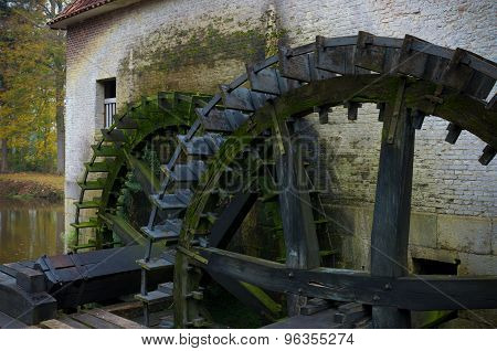 wooden wheels of an ancient watermill in the netherlands
