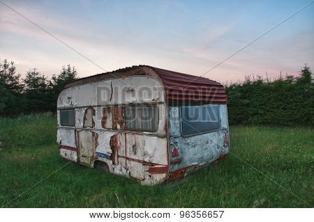Old White Camper In Forest In Summer Morning