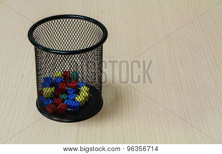 Paper Tack In Black Basket On The Wood Background.