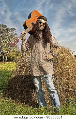 Portrait Of Hippie Man With A Guitar