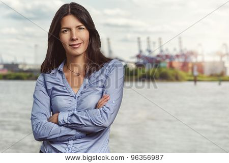 Confident Pretty Woman Against River Background
