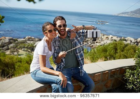 couple takes a selfie with a beautiful ocean background