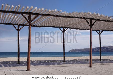 Wooden Shelter On The Beach Near The Sea