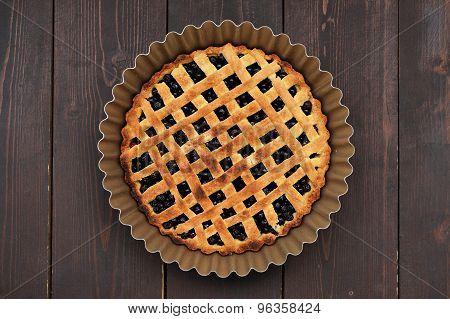 Freshly Baked Round Homemade Lattice Blueberry Pie In Baking Dish On Wooden Table