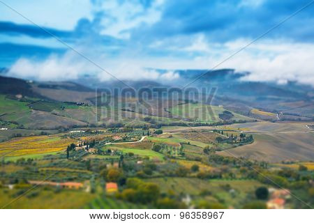 Tuscany Panoramic Landscape With Fields, Trees And Houses